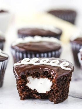 A Bitten Hostess Cupcake with Marshmallow Filling in the Middle
