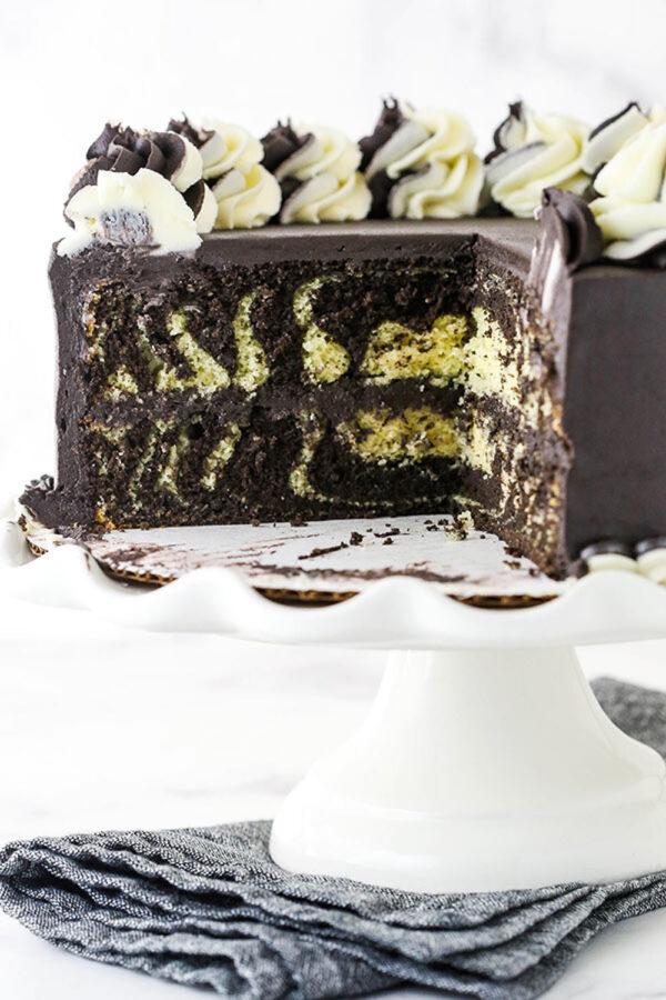 Three Quarters of a Zebra Layer Cake on a Dessert Stand