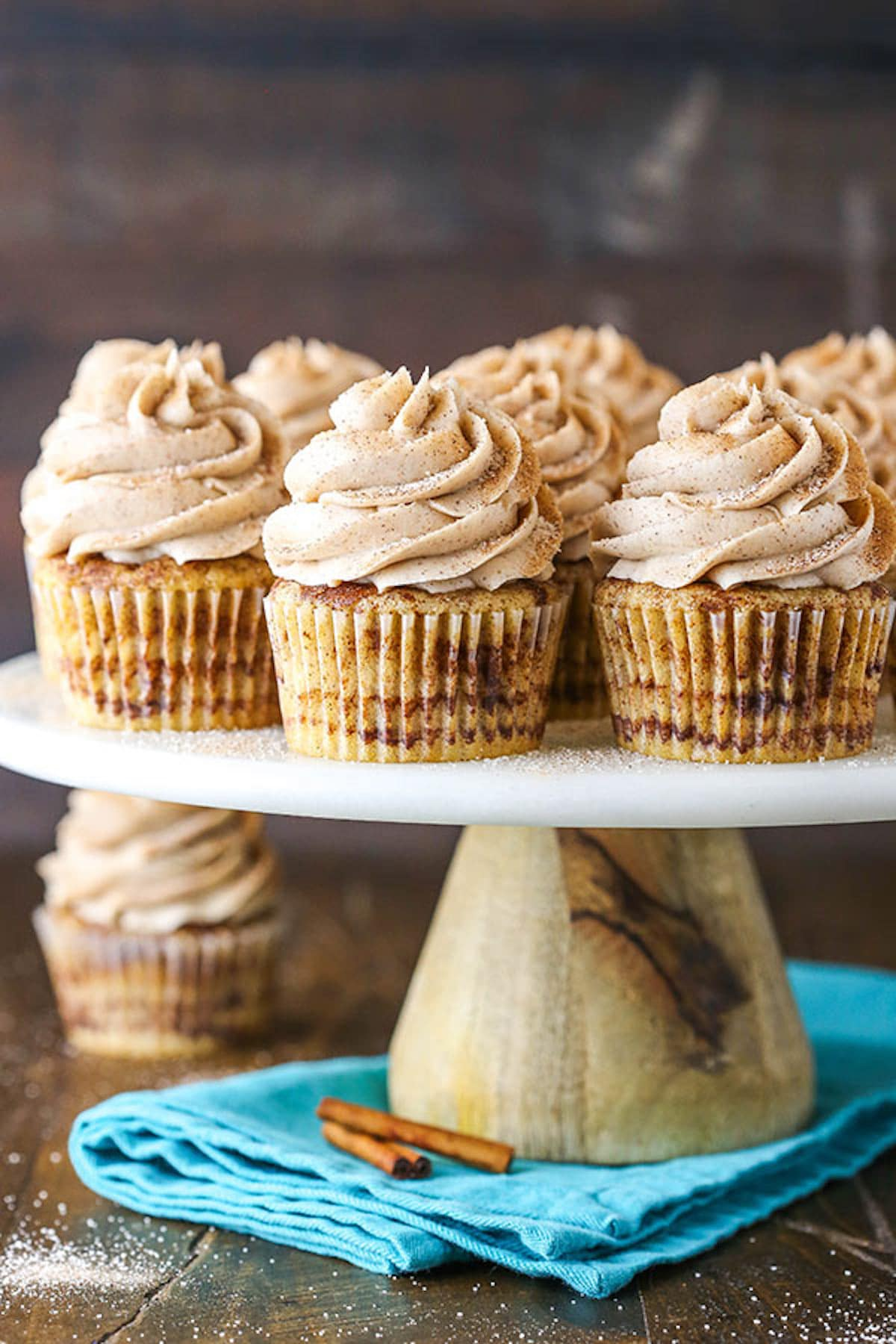 Frosted Cinnamon Cupcakes Arranged on a Cake Stand