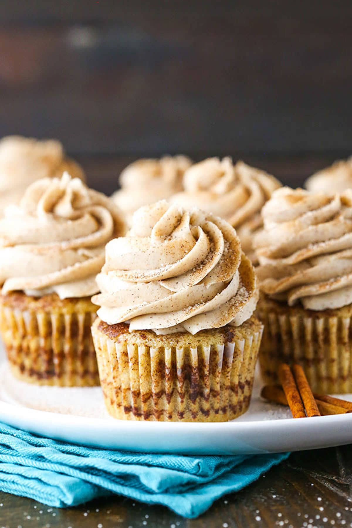 A White Plate Full of Cinnamon Sugar Swirl Cupcakes with Cinnamon Frosting