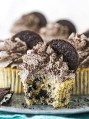 An Oreo Cupcake on a Serving Platter with a Bite Taken Out of It