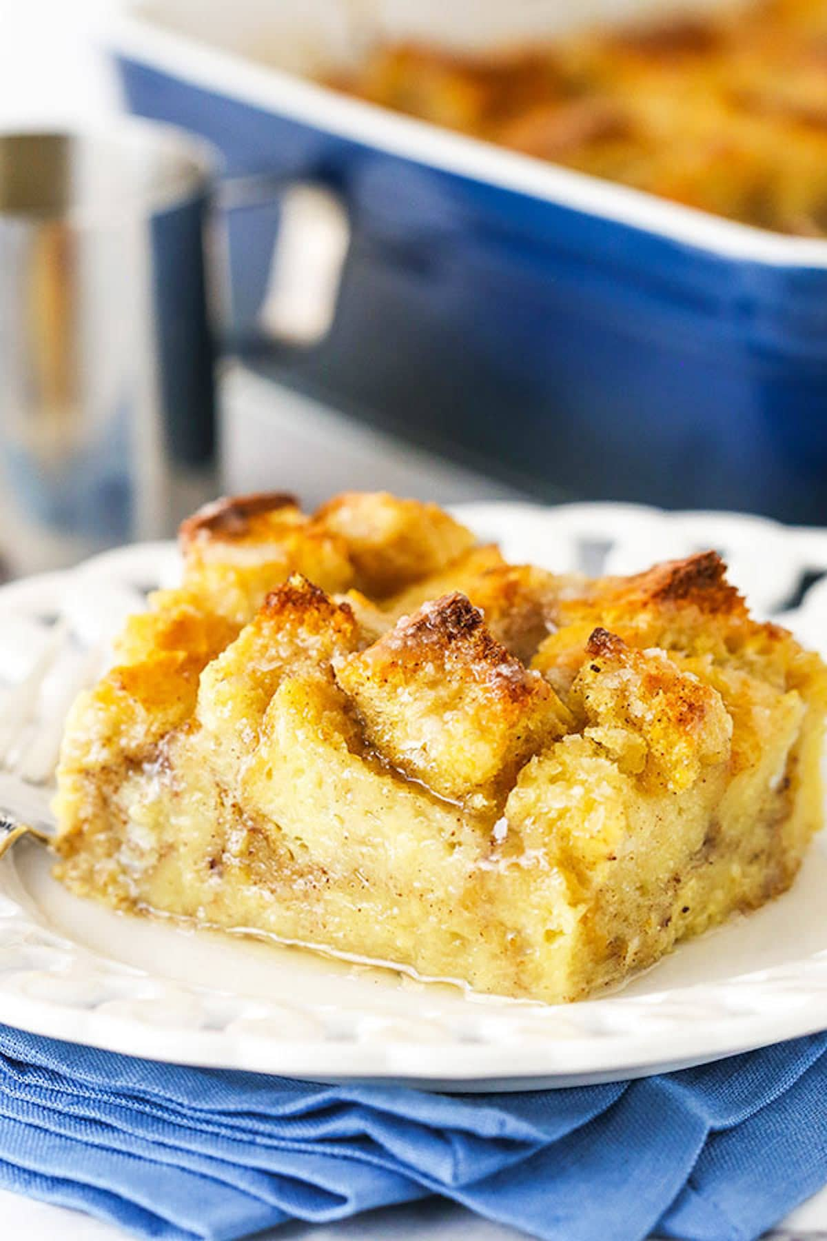 A Helping of Bread Pudding Sitting on a Plate on Top of a Blue Napkin