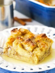 One Serving of Bread Pudding on a White Plate
