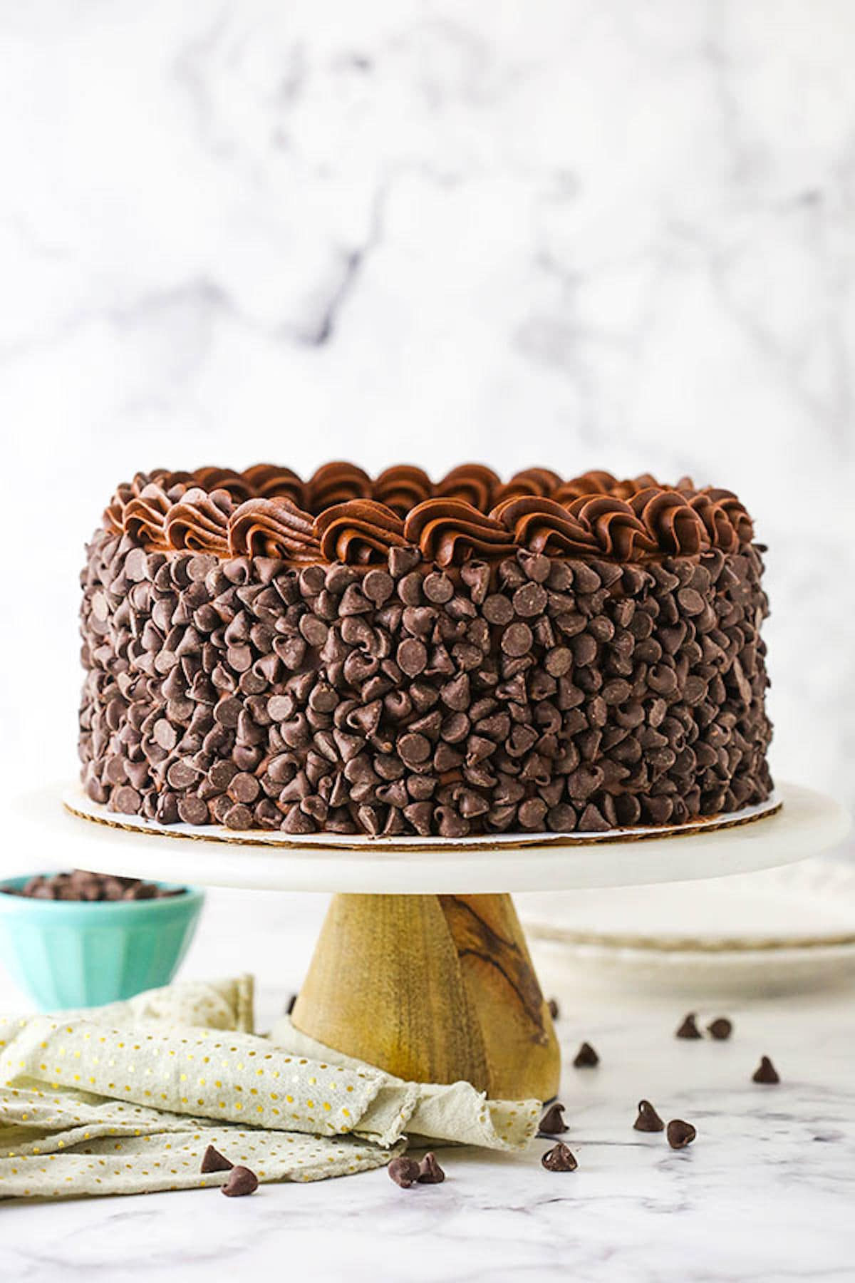 A Wooden Cake Stand Holding a Hershey's Chocolate Cake Cheesecake