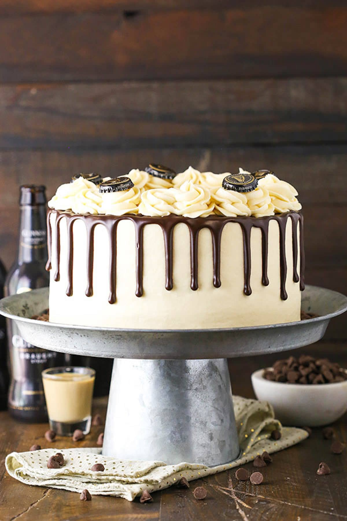 A Metal Cake Stand Holding a Decorated Guinness Chocolate Cake