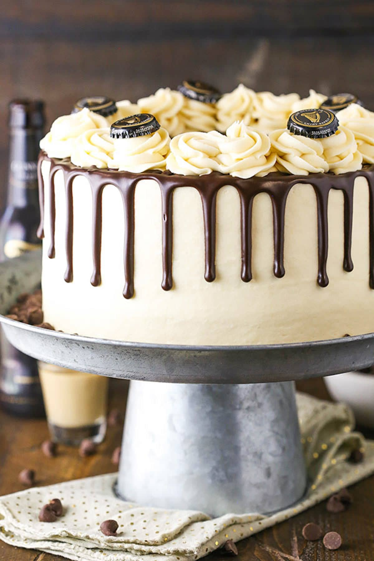 A Guinness Cake with a Chocolate Ganache Drip Design on a Cake Stand