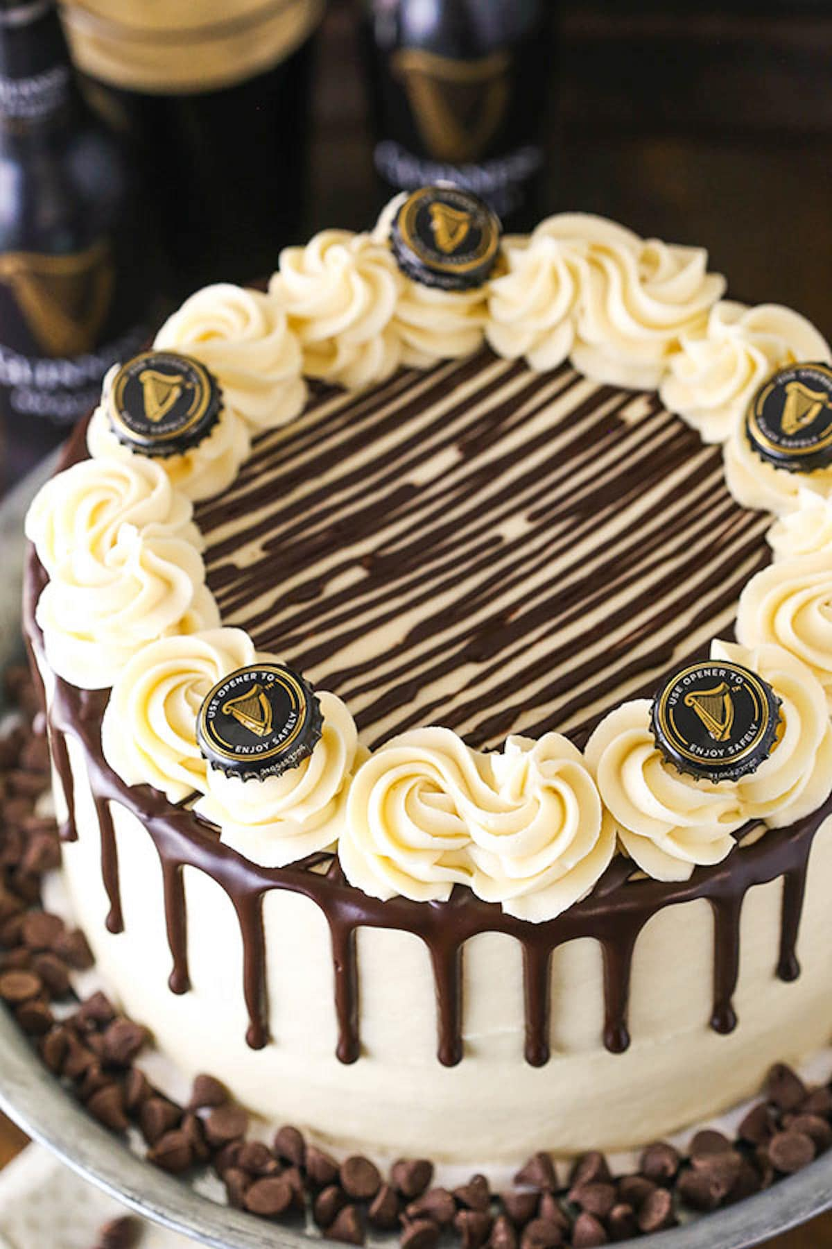 A Guinness Chocolate Layer Cake Decorated with Guinness Bottle Caps
