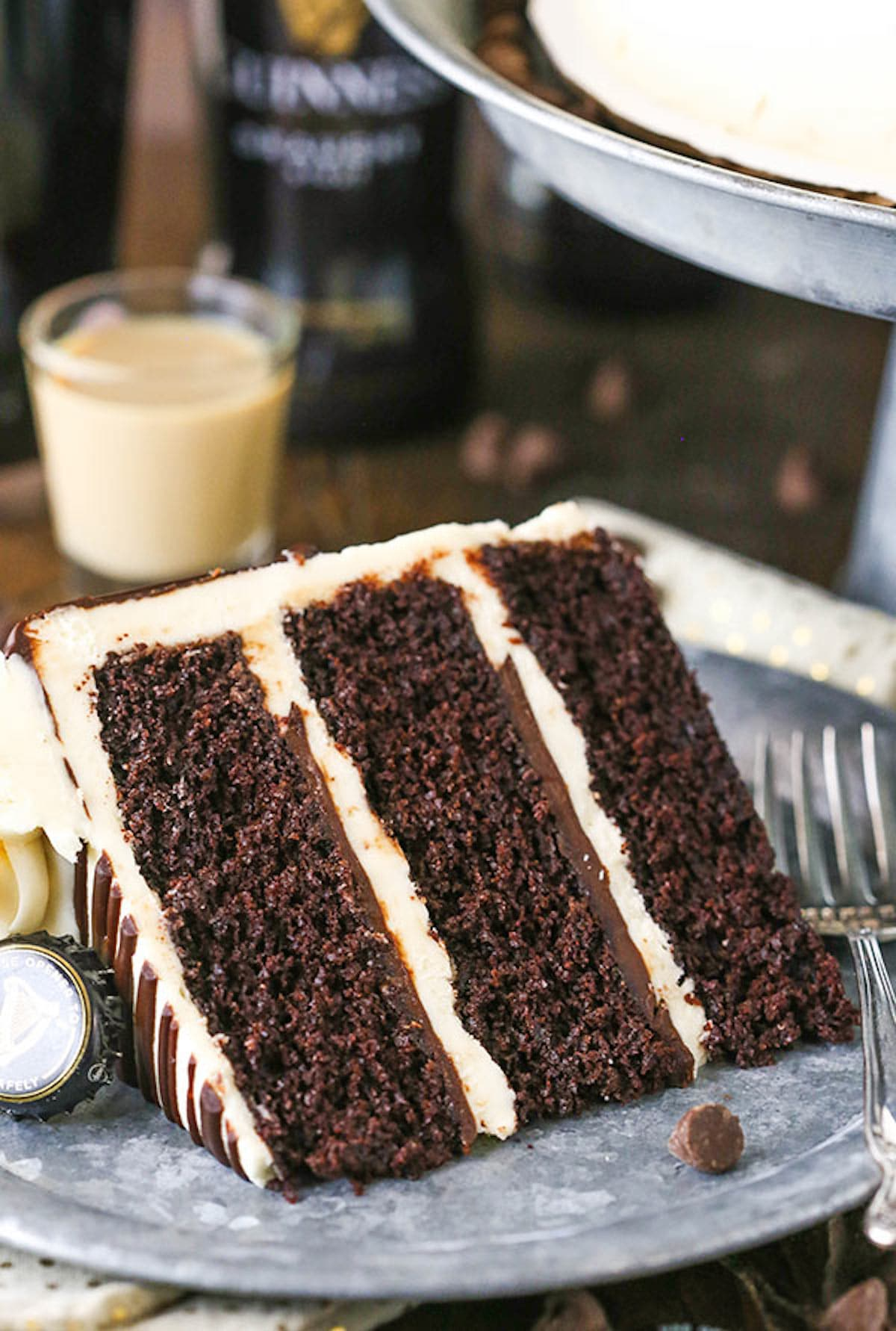 A Slice of Guinness Layer Cake with Baileys Frosting on a Plate