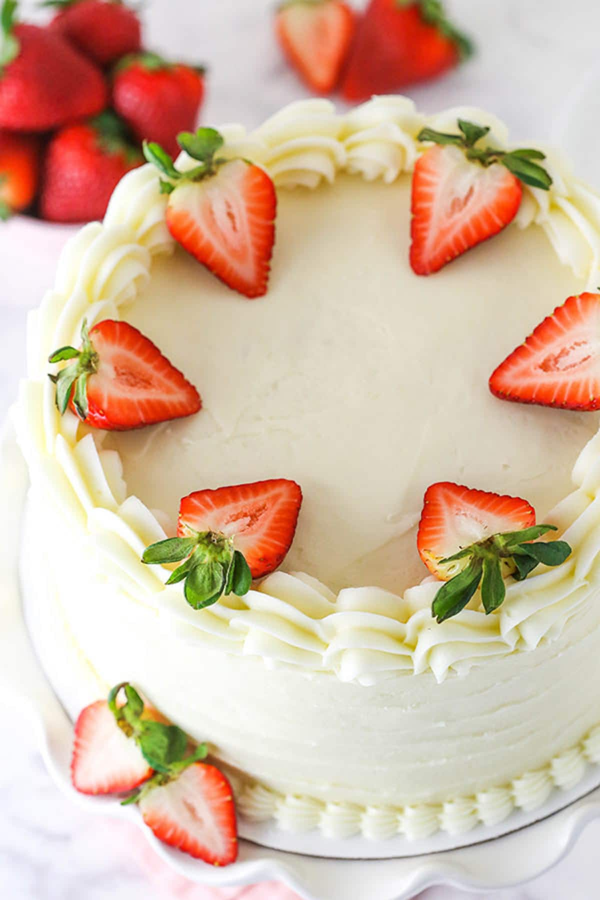 A Strawberry Layer Cake Garnished With Fresh Strawberry Slices