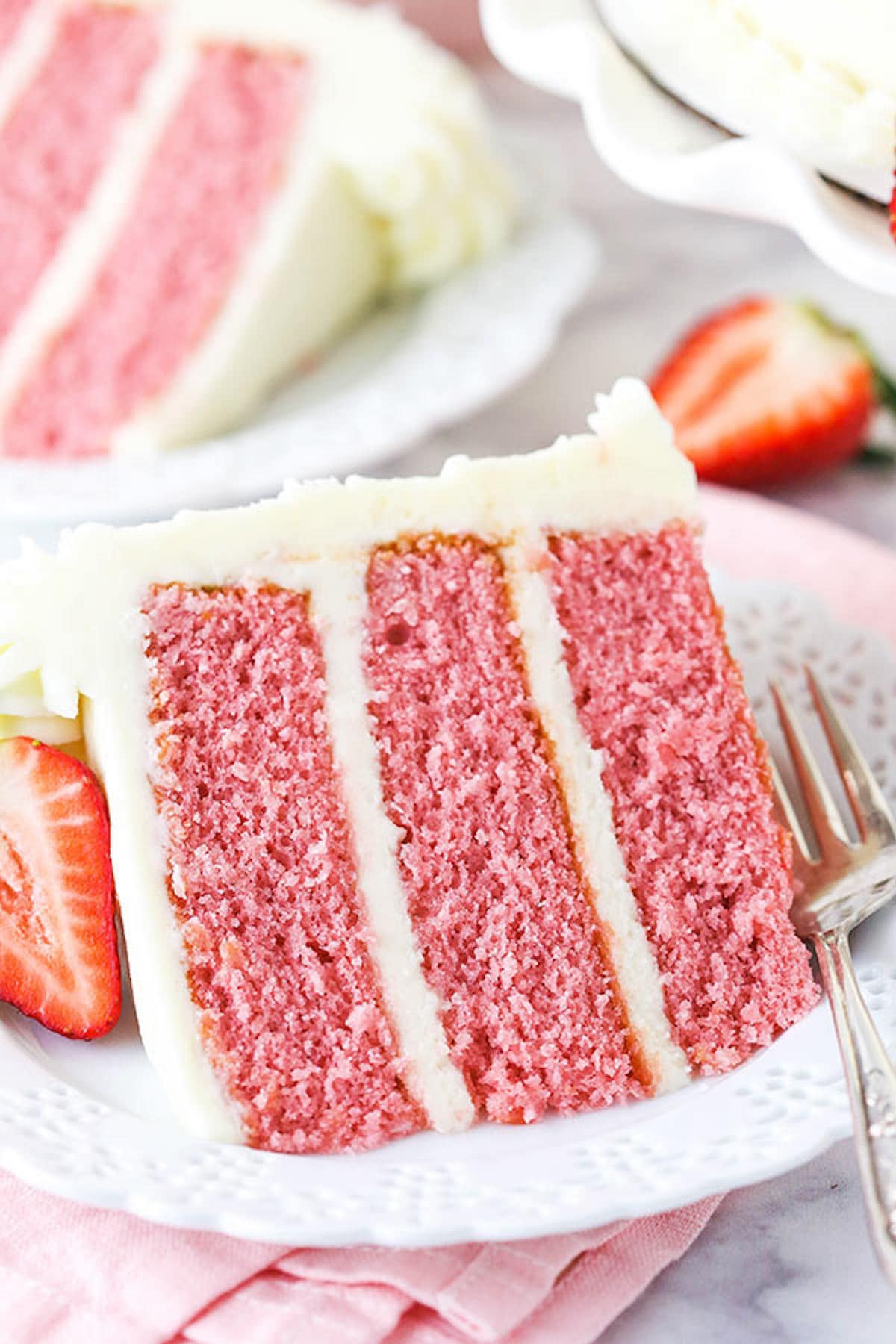 A Slice of Strawberry Cake on a White Dessert Plate