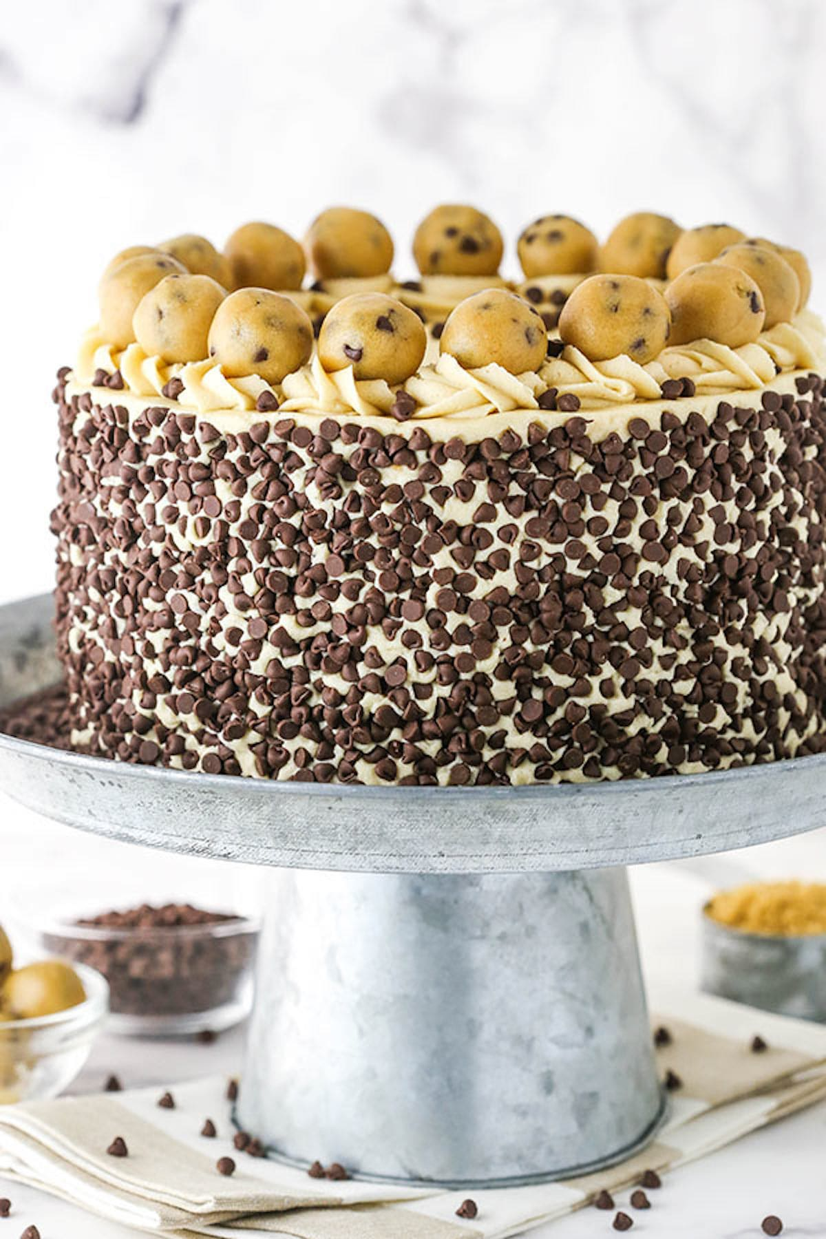 A Chocolate Chip Layer Cake on Top of a Metal Cake Stand