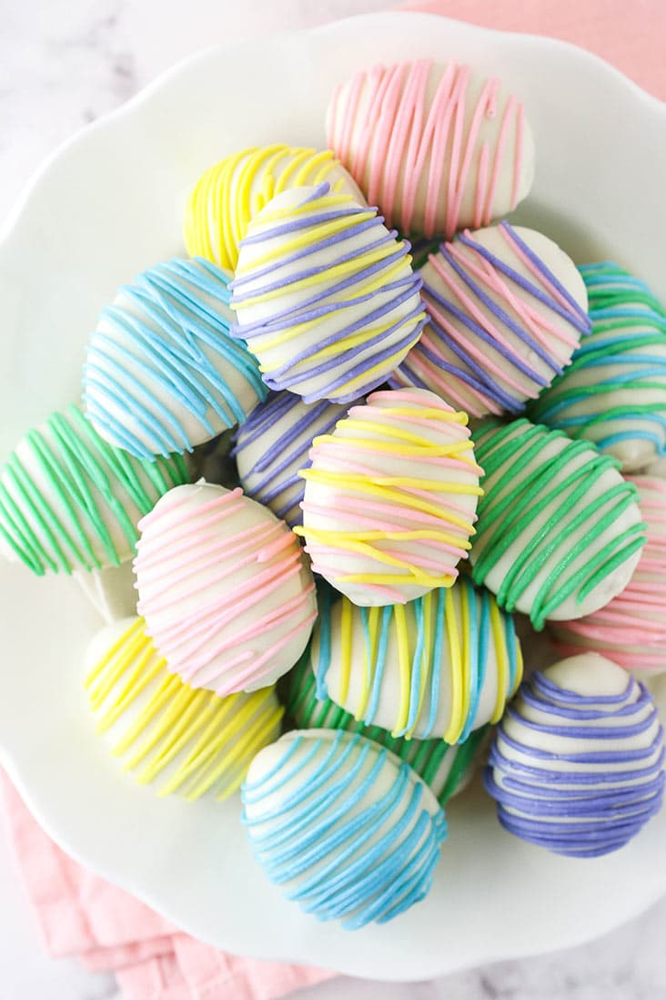 overhead image of easter egg oreo cookie balls in a white bowl