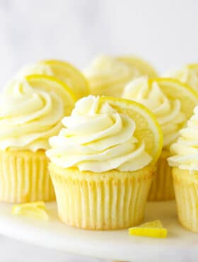 Lemon Cupcakes on a Cake Stand with Slices of Fresh Lemon