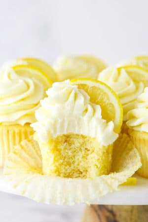 A Frosted Lemon Cupcake with One Bite Taken Out