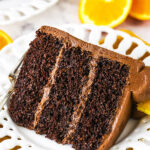 orange chocolate cake slice on a white plate