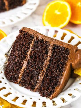 orange chocolate cake slice on a white plate