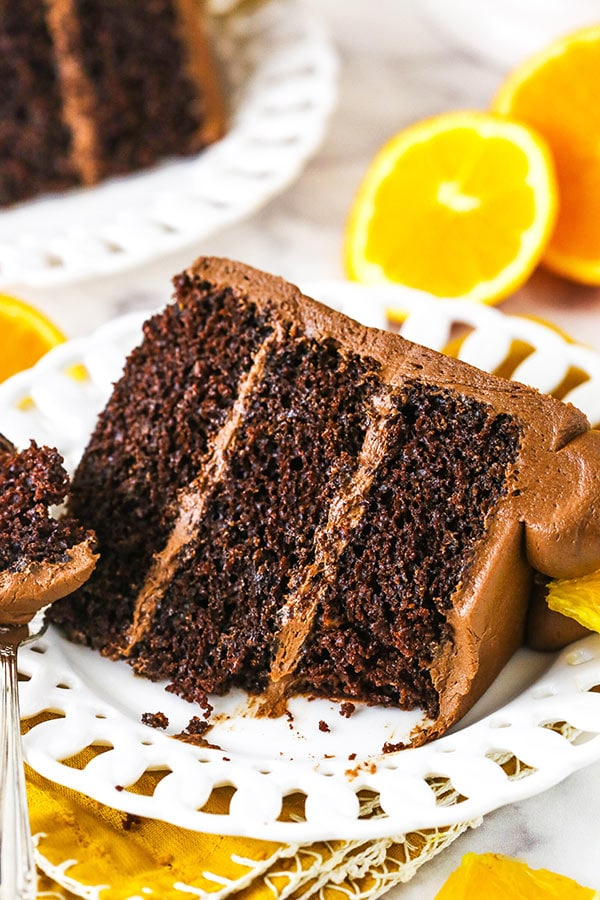 slice of orange chocolate cake with a bite taken