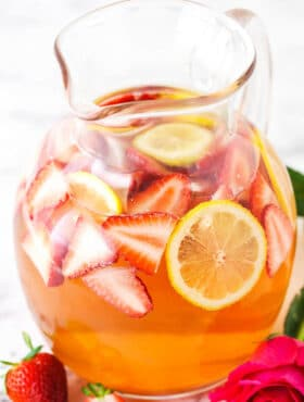 Rosewater Rosé Sangria with slices of strawberries and lemon