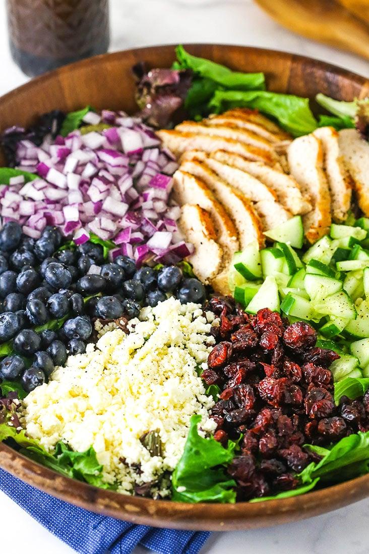 A big bowl of chicken blueberry feta salad