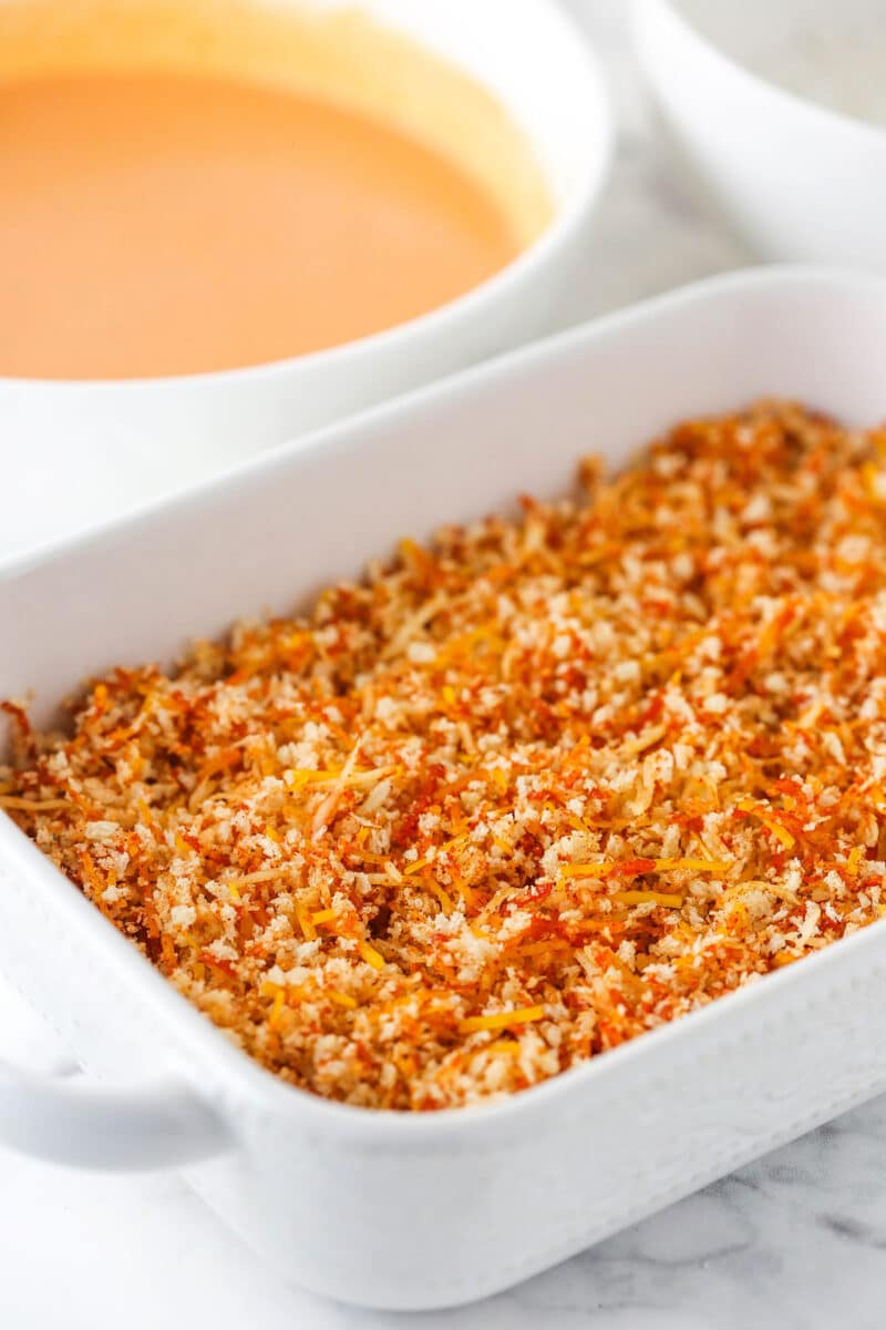 panko mixture in white dish with buffalo mixture in background