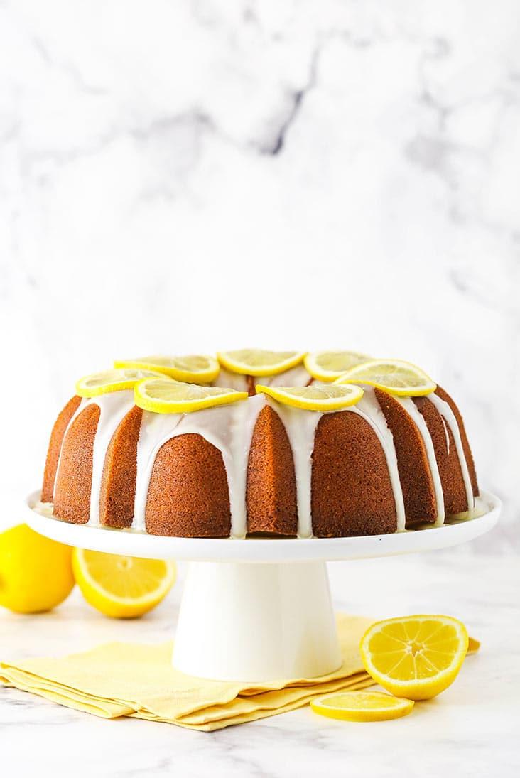 Lemon pound cake with lemon icing drizzle and lemon slices.