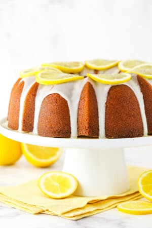 Lemon pound cake with lemon icing on a serving platter.
