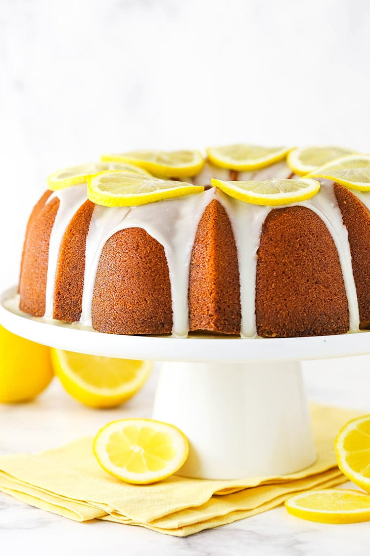 Lemon pound cake with lemon icing on a serving platter.