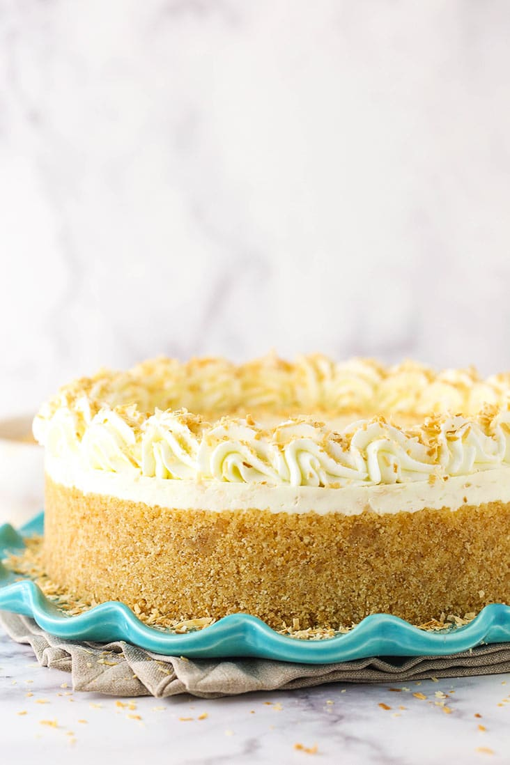 A no bake toasted coconut cheesecake with homemade vanilla wafer crust on a blue plate.