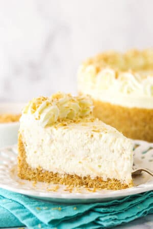 Side view of a slice of no bake toasted coconut cheesecake