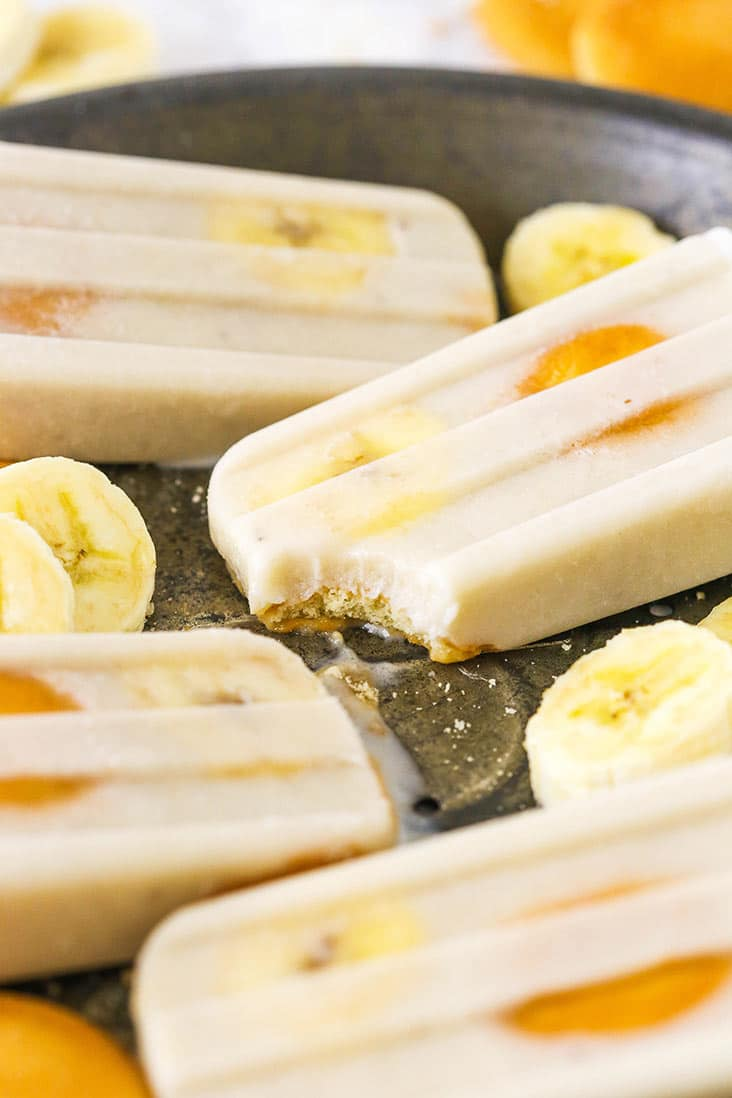 Banana popsicles with a bite missing from one