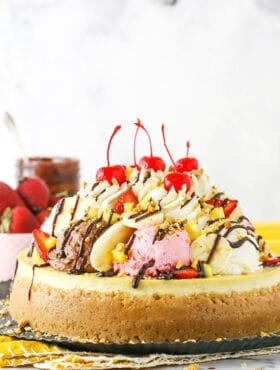 banana split cheesecake from the side on metal serving tray
