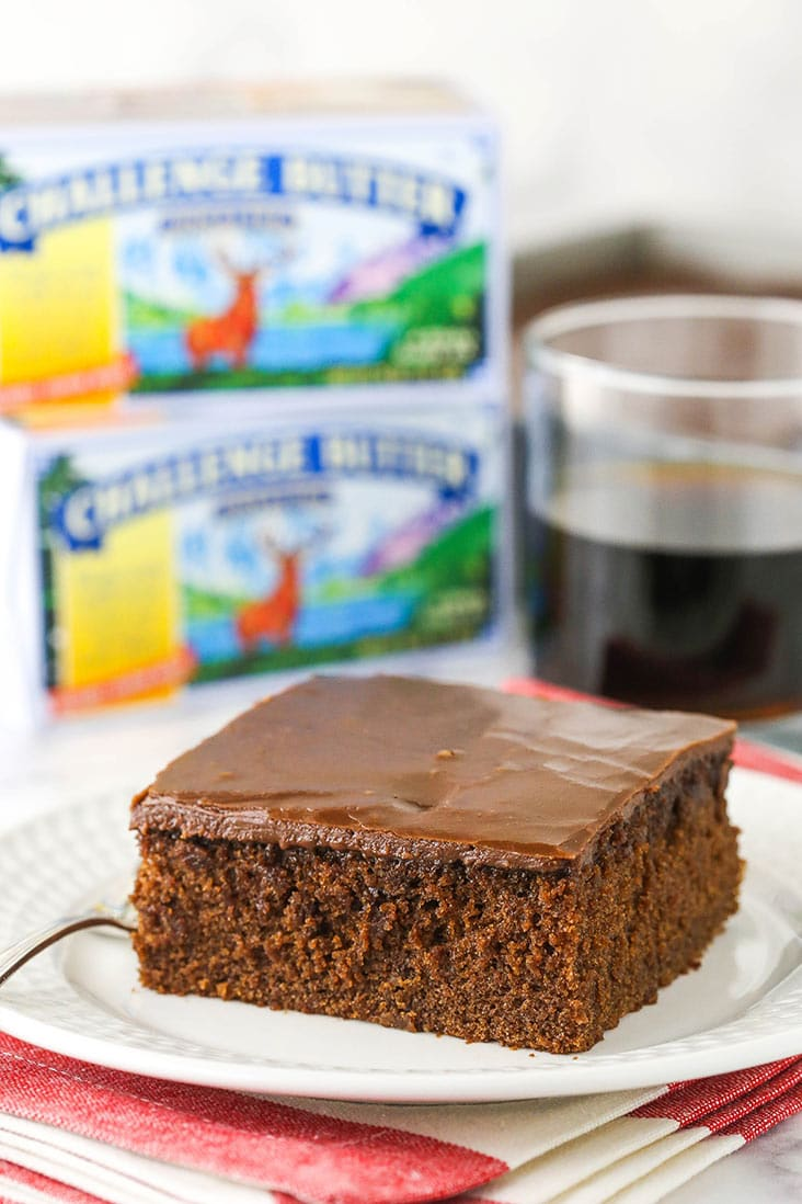 slice of coca cola cake with challenge butter in background