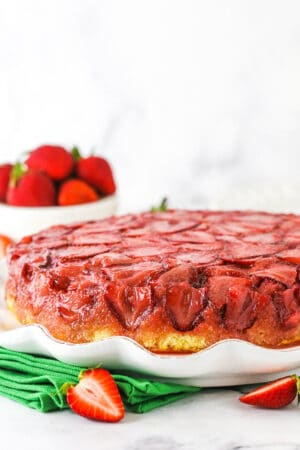 Strawberry upside down cake on a serving platter