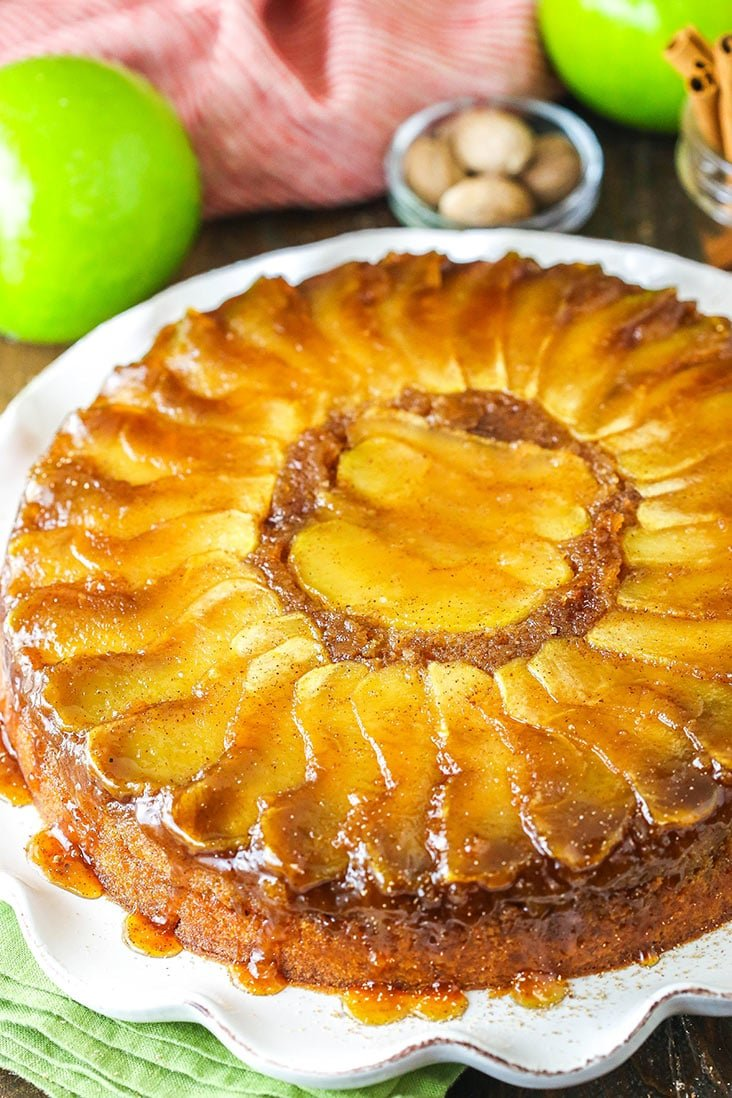 Apple upside down cake on a white serving dish