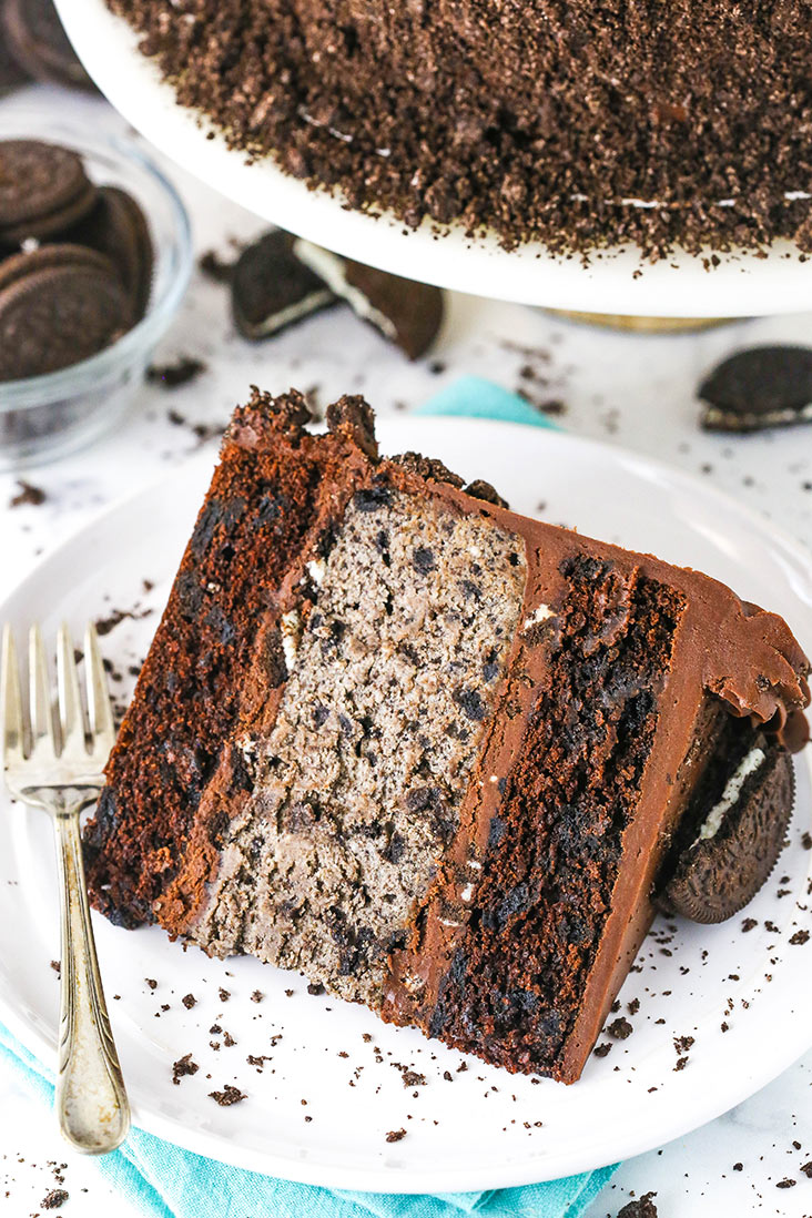 A slice of cookies and cream cheesecake cake