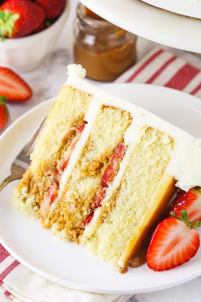 slice of Strawberry Dulce De Leche Cake on white plate