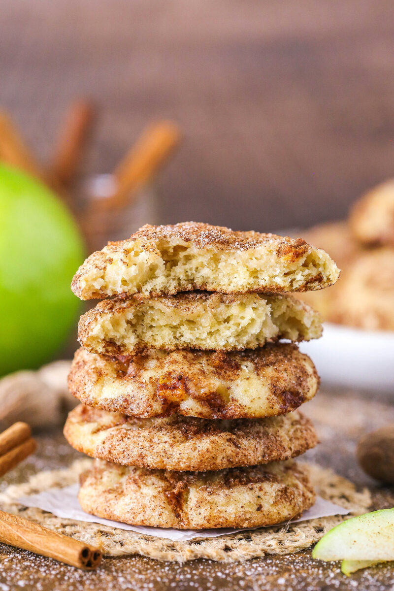 apple snickerdoodles in a stack with broken cookie on top