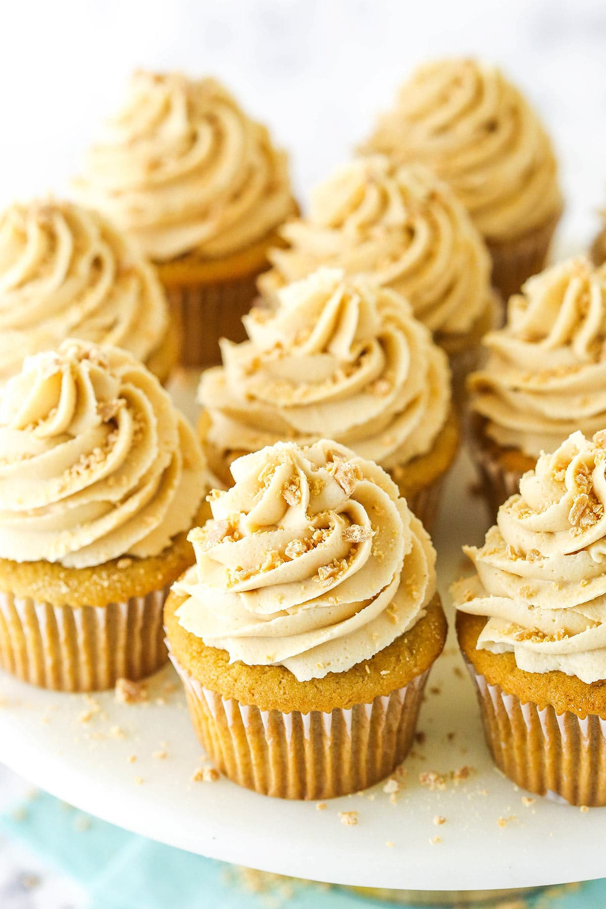 Peanut butter cupcakes with peanut butter frosting and crushed peanut butter chips on top