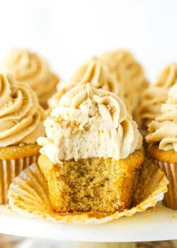 An unwrapped peanut butter cupcake with a bite taken out to reveal the fluffy interior