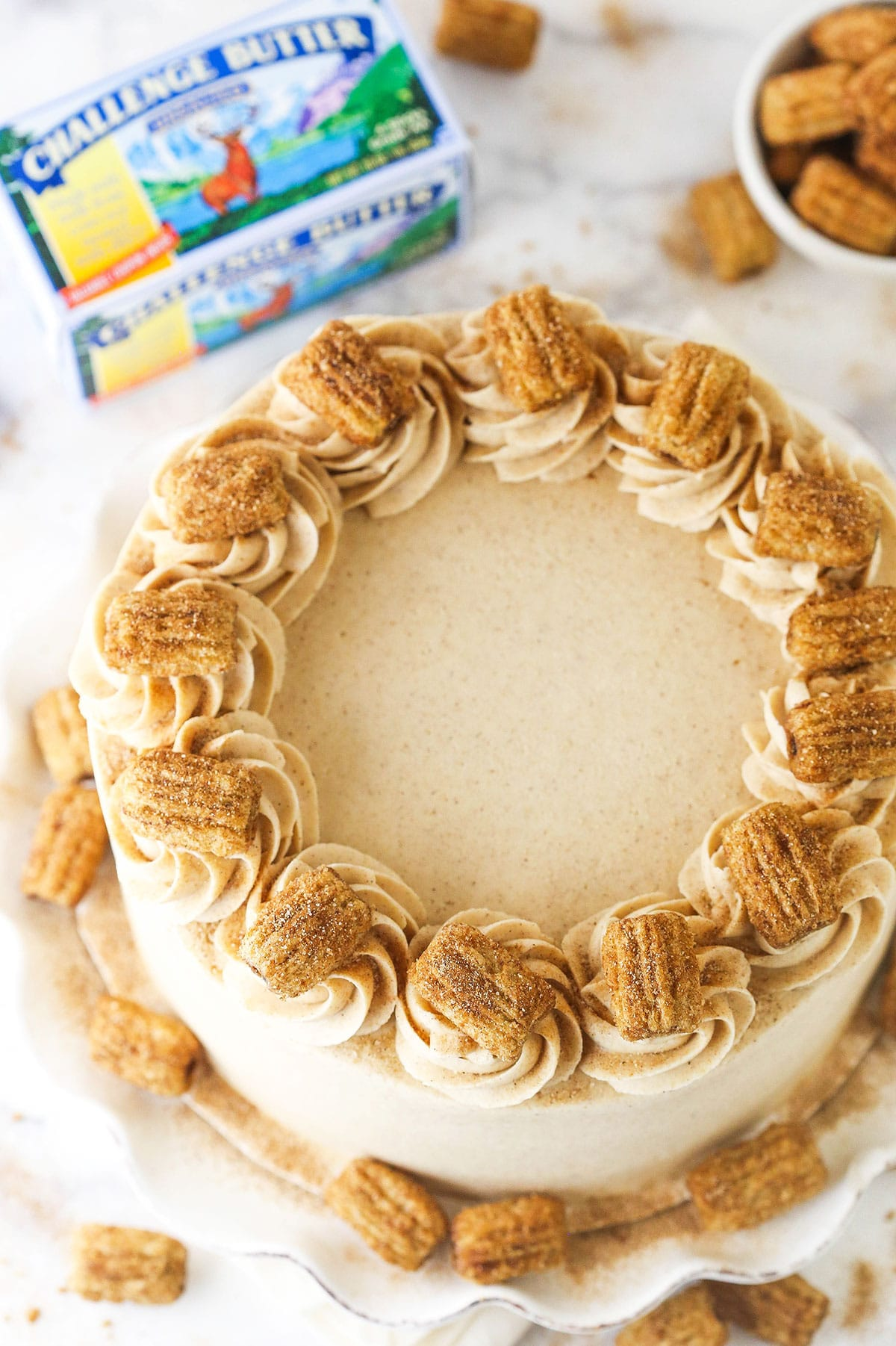 overhead image of churro layer cake with challenge butter next to it