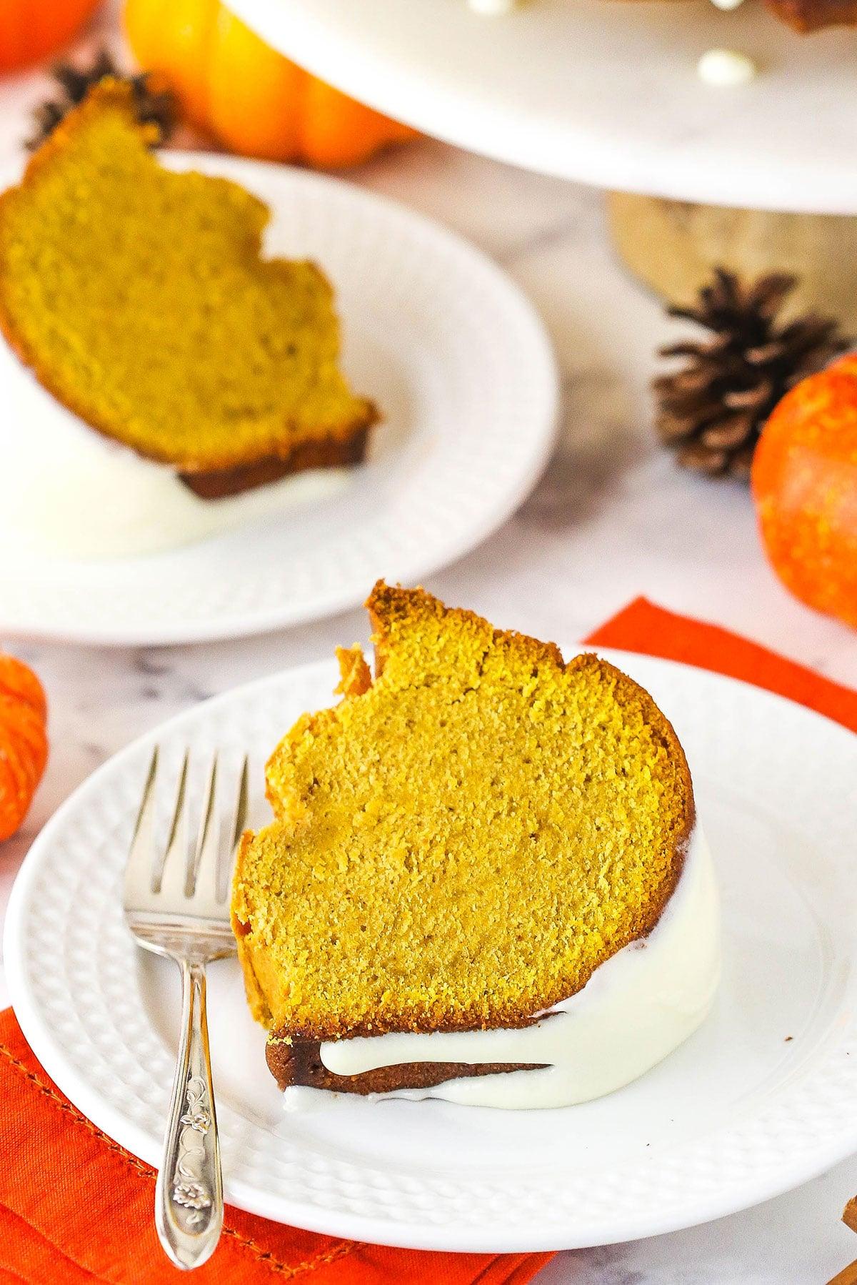 pumpkin pound cake slice on white plate with orange napkin