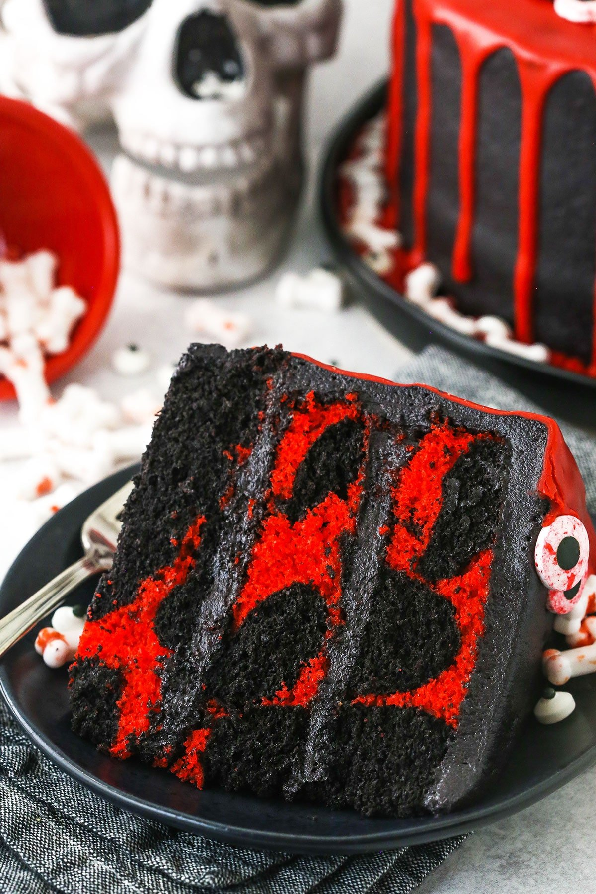 red and black marble cake on black plate