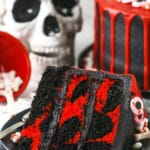 red and black. marble cake slice with skull in the background